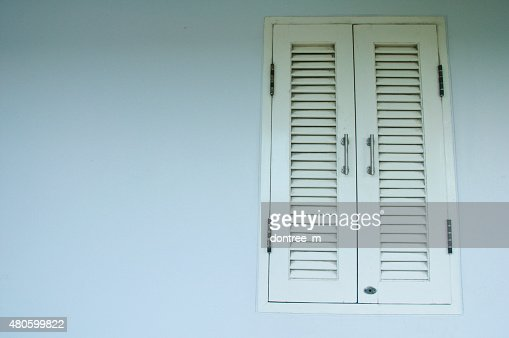 Ventilation door on a wall of an industrial building : Stock Photo