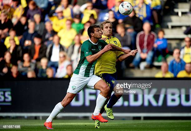 Ventislav Vasilev of PFC Beroe Stara Zagora and Teemu Pukki of Brondby IF compete for the ball during the UEFA Europa League Qualification match...