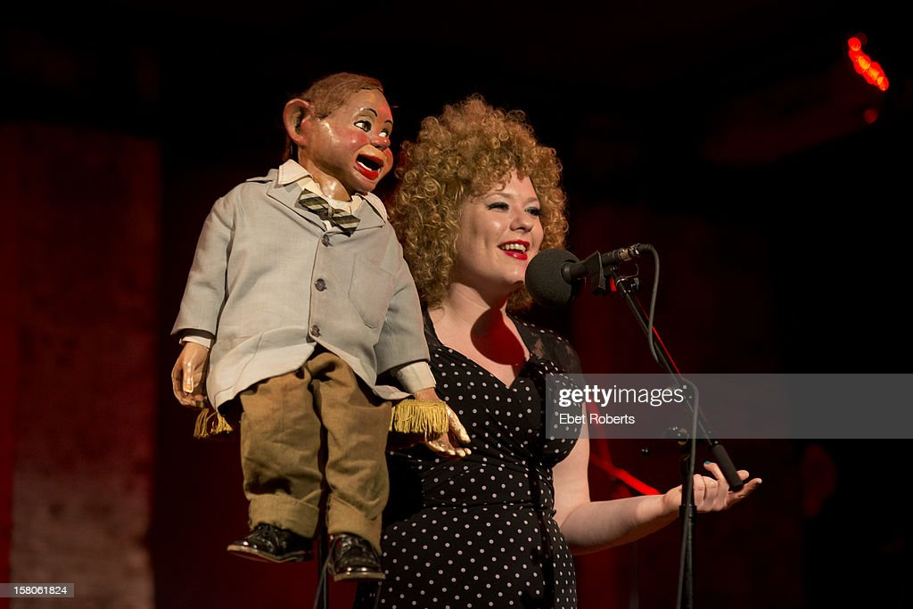 Ventriloquist Carla Rhodes and Cecil perform on stage at John Wesley Harding's Cabinet of Wonders at City Winery in New York on 16th November 2012.