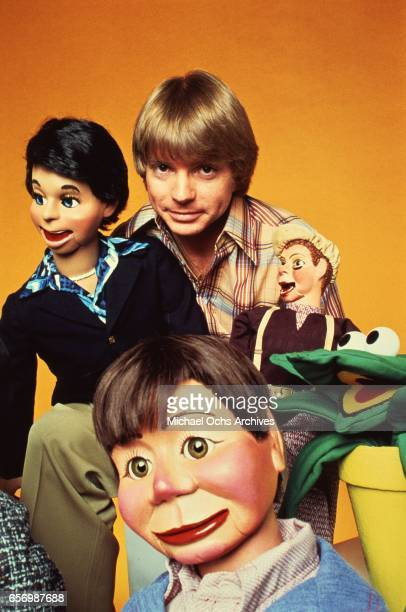 Ventriloquist Jay Johnson poses for a portrait with his puppets in circa 1977