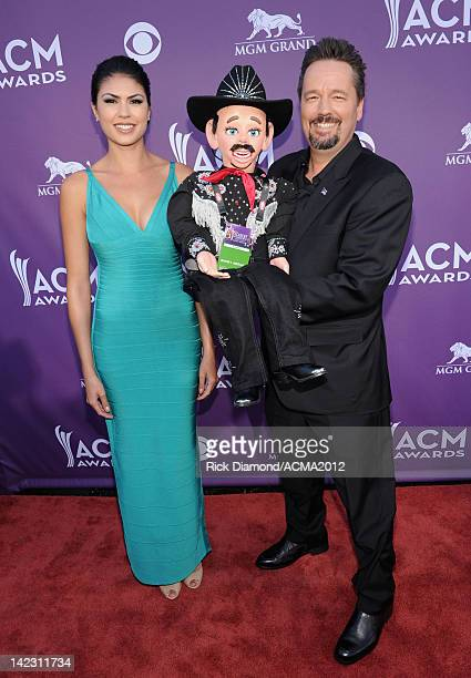 Ventriloquist Terry Fator with his character Walter T Airedale and Taylor Makakoa arrives at the 47th Annual Academy Of Country Music Awards held at...