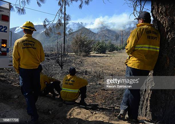 Ventura County firefighters look at a hillside as it continues to burn near Lake Hughes on June 3 2013 in Palmdale California Nearly 2200...