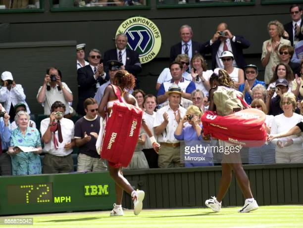 Venus and Serena Williams at the end of their semi final match July 2000 at Wimbledon walking off the court