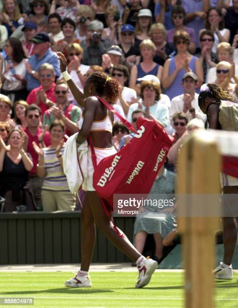 Venus and Serena Williams at the end of their Wimbledon July 2000 semi final match walking off court