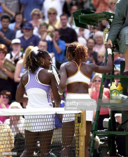 Venus and Serena Williams at the end of their Wimbledon July 2000 semi final match
