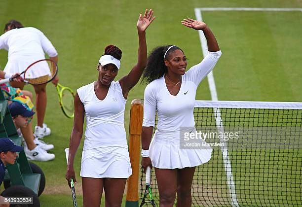 Venus and Serena Williams of The United States celebrates victory during the Ladies Doubles first round match against Andreja Klepac of Slovakia and...