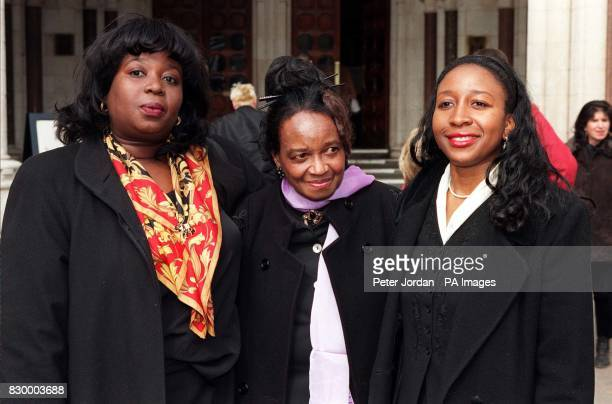Venus Francisco mother of murdered doctor Joan Franciso with her other two daughters Celia and Margrette outside the High Court in London today after...