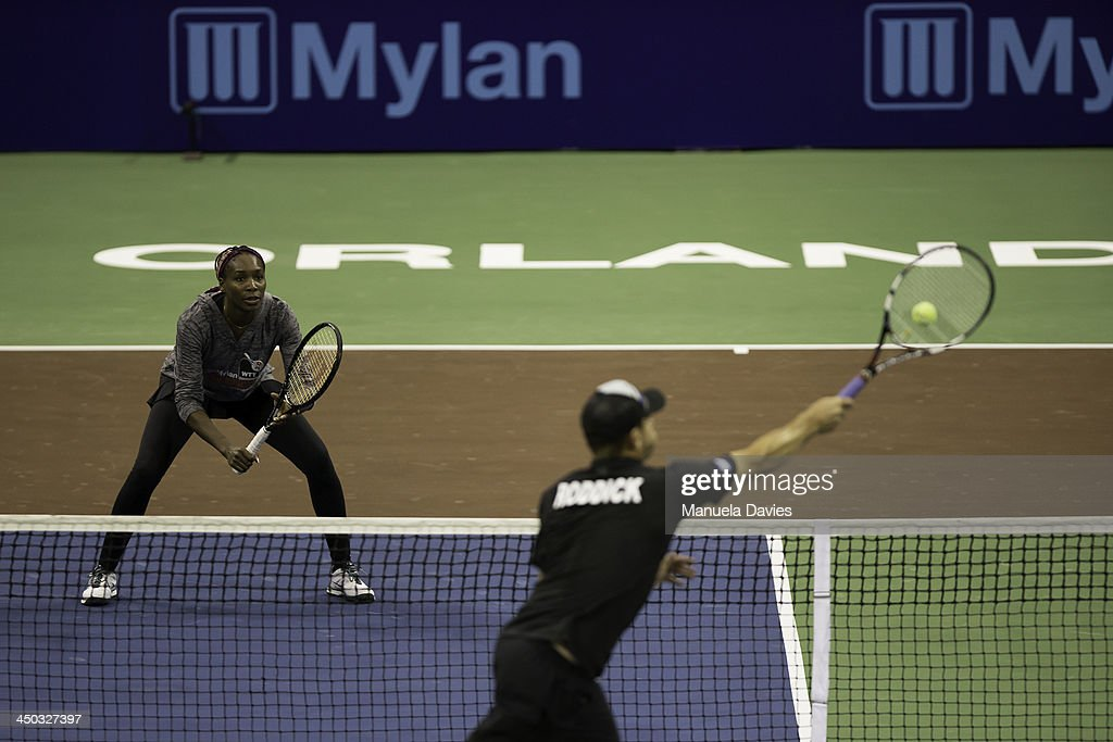 <a gi-track='captionPersonalityLinkClicked' href=/galleries/search?phrase=Venus+Williams&family=editorial&specificpeople=171981 ng-click='$event.stopPropagation()'>Venus Williams</a> and <a gi-track='captionPersonalityLinkClicked' href=/galleries/search?phrase=Andy+Roddick&family=editorial&specificpeople=167084 ng-click='$event.stopPropagation()'>Andy Roddick</a> of the U.S. during the exhibition doubles match with Elton John and Marion Bartoli during the 2013 Mylan WTT Smash Hits on November 17, 2013 at the ESPN Wide World of Sports Complex in Lake Buena Vista, Florida.