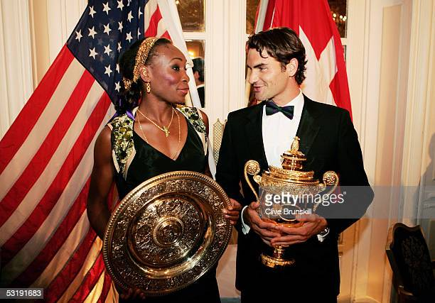 Venus Williams and Roger Federer pose with the trophies at the Wimbledon Winners Dinner at the Savoy Hotel on July 3 2005 in London