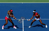 Venus Williams and Serena Williams of the United States return a shot against Ekaterina Makarova and Elena Vesnina of Russia during their women's...