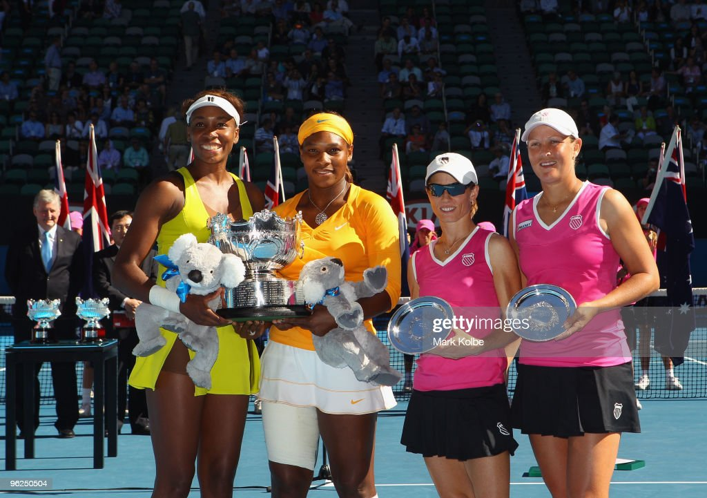 <a gi-track='captionPersonalityLinkClicked' href=/galleries/search?phrase=Venus+Williams&family=editorial&specificpeople=171981 ng-click='$event.stopPropagation()'>Venus Williams</a> and <a gi-track='captionPersonalityLinkClicked' href=/galleries/search?phrase=Serena+Williams&family=editorial&specificpeople=171101 ng-click='$event.stopPropagation()'>Serena Williams</a> of the USA and <a gi-track='captionPersonalityLinkClicked' href=/galleries/search?phrase=Cara+Black&family=editorial&specificpeople=204313 ng-click='$event.stopPropagation()'>Cara Black</a> of Zimbabwe and <a gi-track='captionPersonalityLinkClicked' href=/galleries/search?phrase=Liezel+Huber&family=editorial&specificpeople=204371 ng-click='$event.stopPropagation()'>Liezel Huber</a> of the USA pose with their trophies after their Women's doubles final match during day twelve of the 2010 Australian Open at Melbourne Park on January 29, 2010 in Melbourne, Australia.