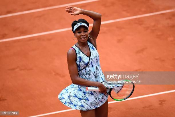 US Venus Williams celebrates after winning against Belgium's Elise Mertens during their tennis match at the Roland Garros 2017 French Open on June 2...
