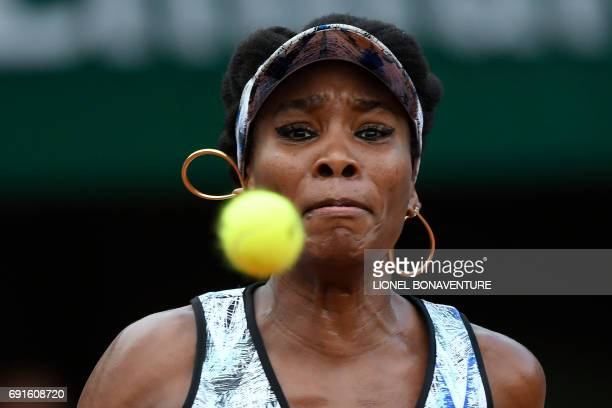 US Venus Williams eyes the ball as she plays against Belgium's Elise Mertens during their tennis match at the Roland Garros 2017 French Open on June...