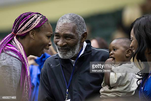 Venus Williams greets father Richard Williams and family during the 2013 Mylan WTT Smash Hits on November 17 2013 at the ESPN Wide World of Sports...