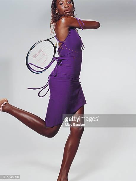 Venus Williams in Purple Dress with Tennis Racket