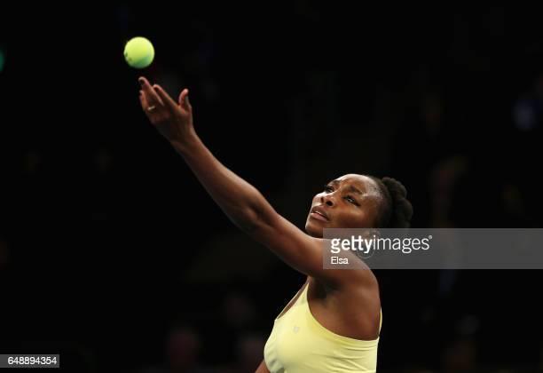 Venus Williams of Team Americas serves against Garbine Murguza and Kei Nishikori of Team World during their Mixed Doubles match at the BNP Paribas...