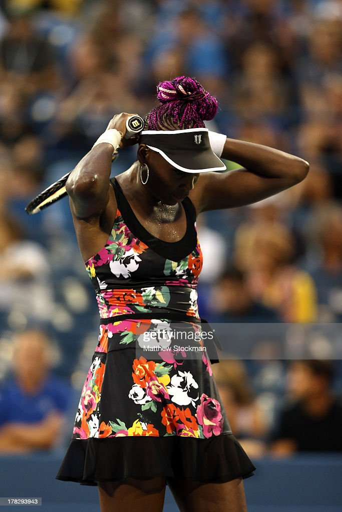 Venus Williams of the United States adjusts her hat during her women's singles second round match against Jie Zheng of China on Day Three of the 2013 US Open at USTA Billie Jean King National Tennis Center on August 28, 2013 in the Flushing neighborhood of the Queens borough of New York City.