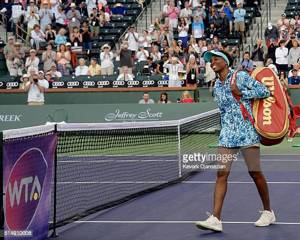 Venus Williams of the United States arrives on court after a 15 year absence from the event during day five of the BNP Paribas Open at Indian Wells...
