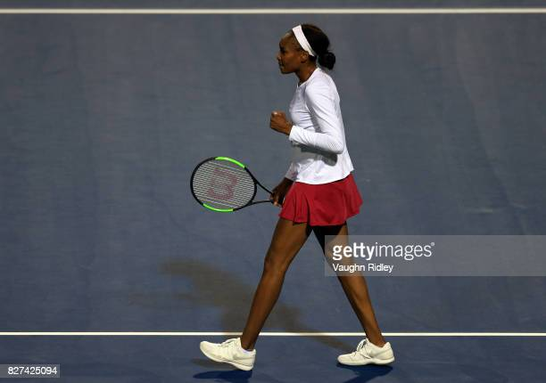 Venus Williams of the United States celebrates after winning her match against IrinaCamelia Begu of Romania during Day 3 of the Rogers Cup at Aviva...
