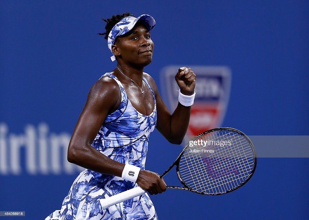 Venus Williams of the United States celebrates match point after defeating Timea Bacsinszky of Switzerland in their women's singles secound round...