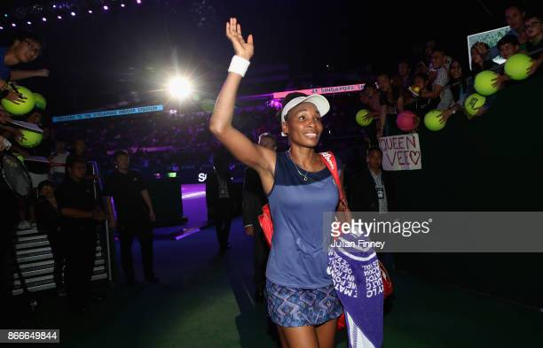 Venus Williams of the United States celebrates victory after her singles match against Garbine Muguruza of Spain during day 5 of the BNP Paribas WTA...