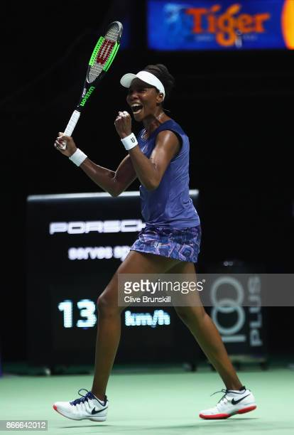 Venus Williams of the United States celebrates victory in her singles match against Garbine Muguruza of Spain during day 5 of the BNP Paribas WTA...