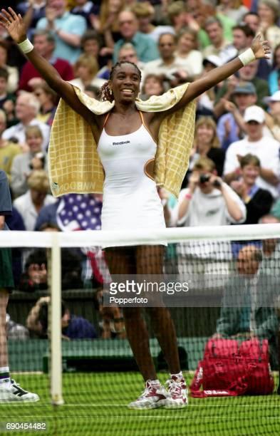 Venus Williams of the United States celebrates winning the ladies singles quarter final match against Martina Hingis of Switzerland during the...