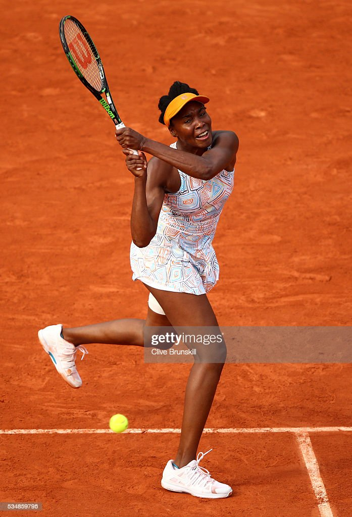 <a gi-track='captionPersonalityLinkClicked' href=/galleries/search?phrase=Venus+Williams&family=editorial&specificpeople=171981 ng-click='$event.stopPropagation()'>Venus Williams</a> of the United States hits a backhand during the Ladies Singles third round match against Alize Cornet of France on day seven of the 2016 French Open at Roland Garros on May 28, 2016 in Paris, France.