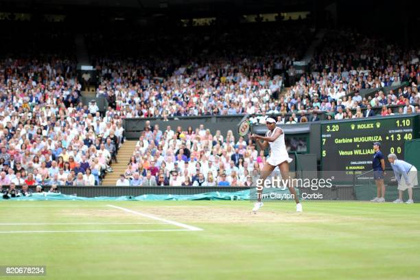 Venus Williams of The United States in action against Garbine Muguruza of Spain in the Wimbledon Lawn Tennis Championships at the All England Lawn...