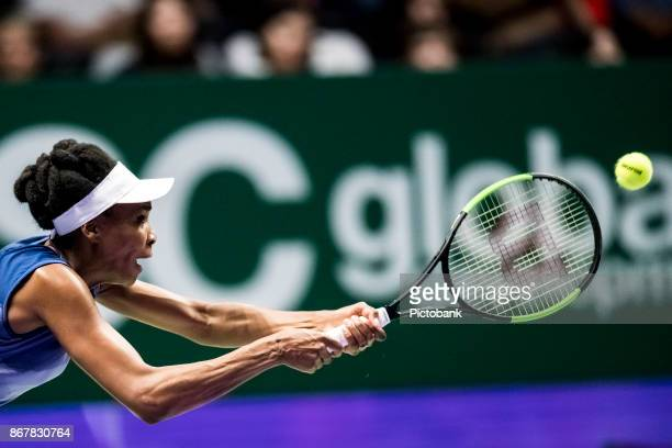 Venus Williams of the United States in action during her singles semi final match against Caroline Garcia of France on day 7 of the BNP Paribas WTA...