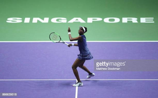 Venus Williams of the United States in action in her singles match against Garbine Muguruza of Spain during day 5 of the BNP Paribas WTA Finals...