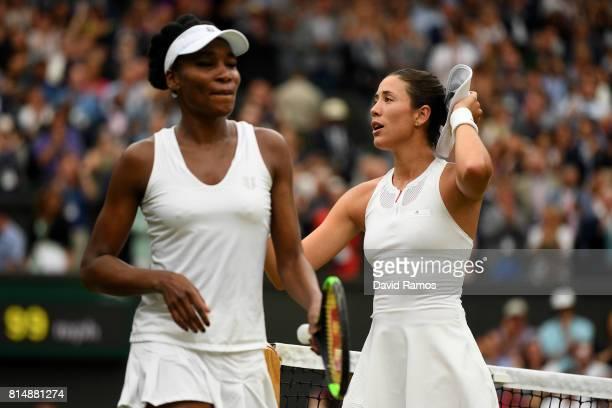 Venus Williams of The United States looks despondent as Garbine Muguruza of Spain celebrates victory after the Ladies Singles final on day twelve of...