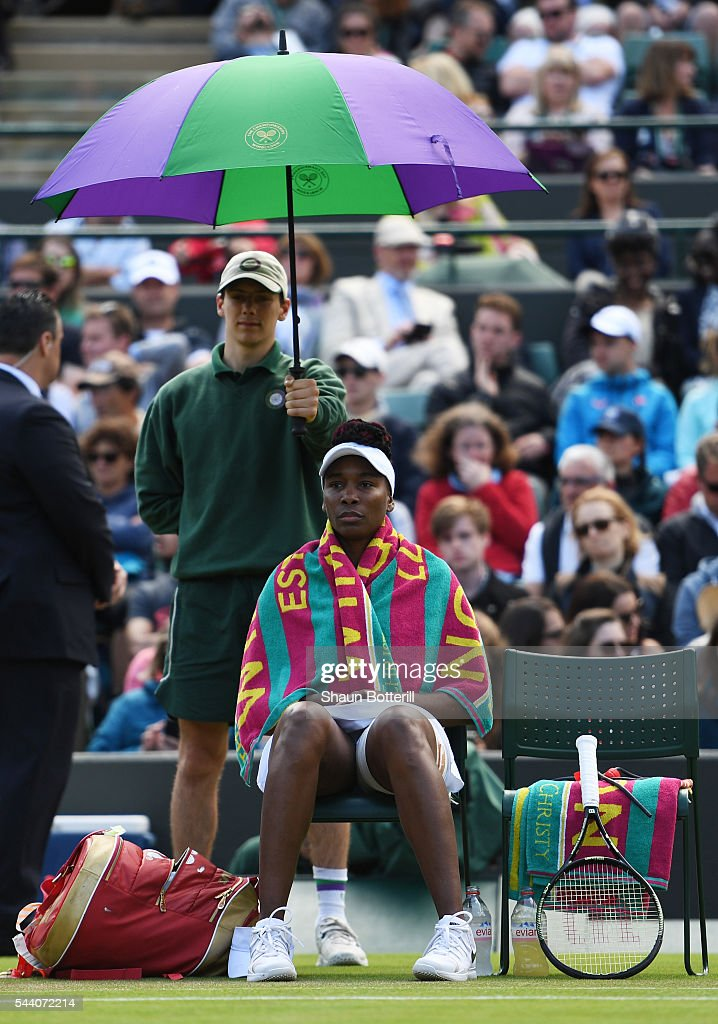 <a gi-track='captionPersonalityLinkClicked' href=/galleries/search?phrase=Venus+Williams&family=editorial&specificpeople=171981 ng-click='$event.stopPropagation()'>Venus Williams</a> of The United States looks on from underneith an umbrella during the Ladies Singles third round match against Daria Kasatkina of Russia on day five of the Wimbledon Lawn Tennis Championships at the All England Lawn Tennis and Croquet Club on July 1, 2016 in London, England.