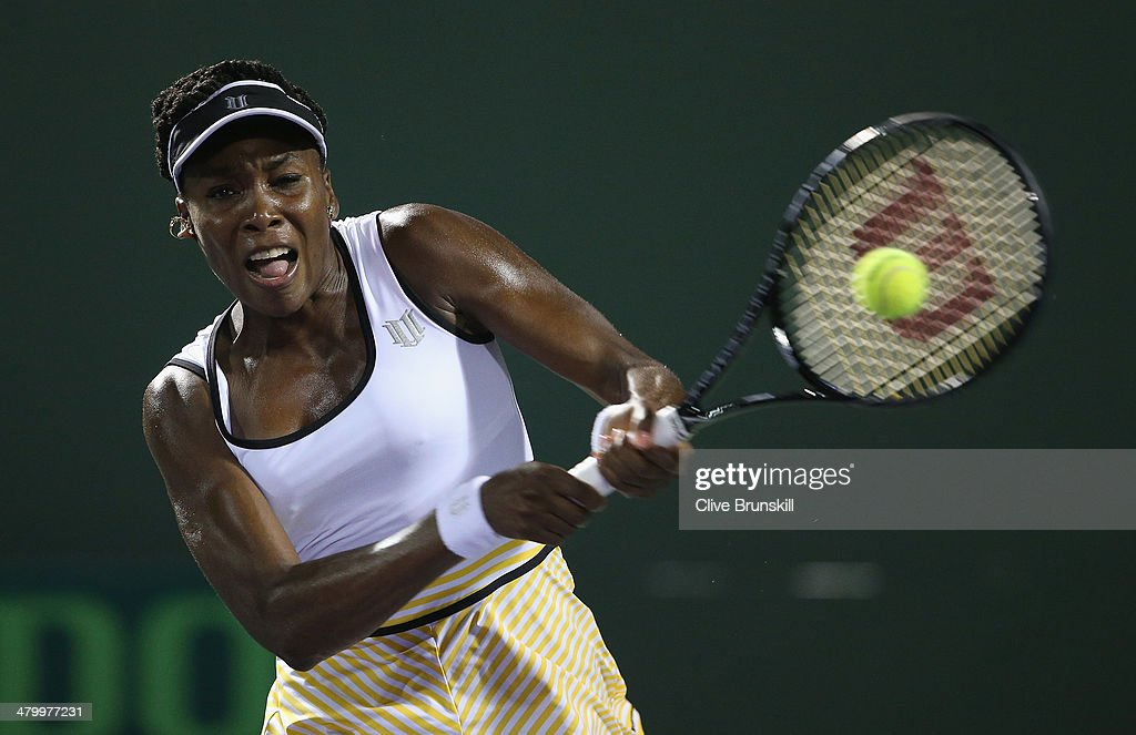 <a gi-track='captionPersonalityLinkClicked' href=/galleries/search?phrase=Venus+Williams&family=editorial&specificpeople=171981 ng-click='$event.stopPropagation()'>Venus Williams</a> of the United States plays a backhand against Anna Schmedlova of Slovakia during their second round match during day 5 at the Sony Open at Crandon Park Tennis Center on March 21, 2014 in Key Biscayne, Florida.