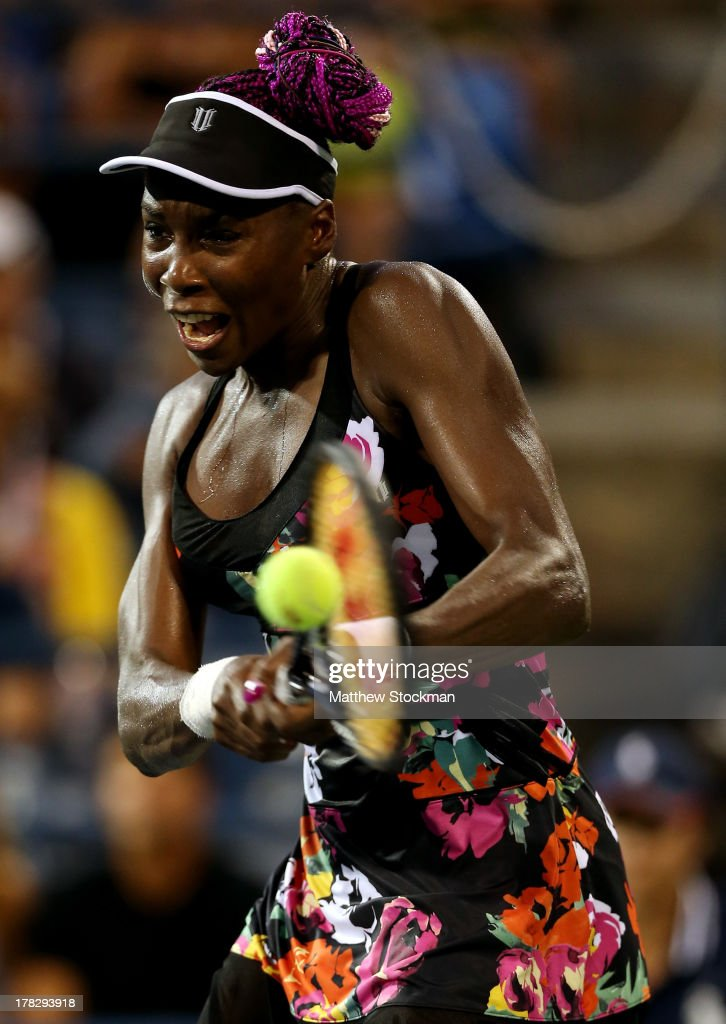 Venus Williams of the United States plays a backhand during her women's singles second round match against Jie Zheng of China on Day Three of the 2013 US Open at USTA Billie Jean King National Tennis Center on August 28, 2013 in the Flushing neighborhood of the Queens borough of New York City.