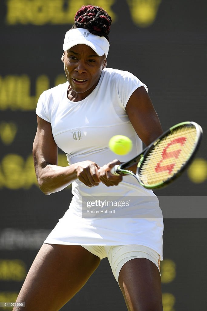 <a gi-track='captionPersonalityLinkClicked' href=/galleries/search?phrase=Venus+Williams&family=editorial&specificpeople=171981 ng-click='$event.stopPropagation()'>Venus Williams</a> of The United States plays a backhand during the Ladies Singles third round match against Daria Kasatkina of Russia on day five of the Wimbledon Lawn Tennis Championships at the All England Lawn Tennis and Croquet Club on July 1, 2016 in London, England.