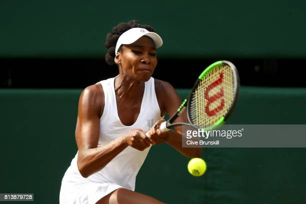 Venus Williams of The United States plays a backhand during the Ladies Singles semi final match against Johanna Konta of Great Britain on day ten of...