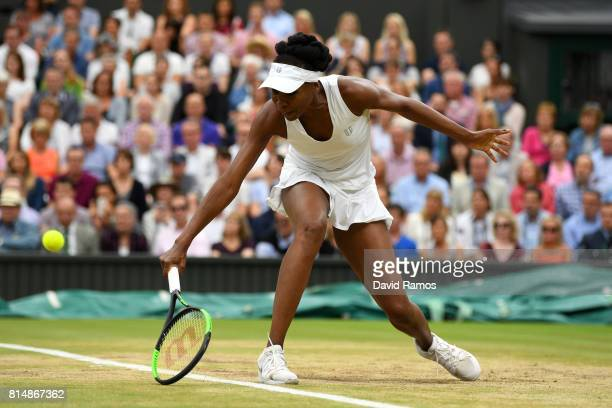Venus Williams of The United States plays a backhand during the Ladies Singles final against Garbine Muguruza of Spain on day twelve of the Wimbledon...