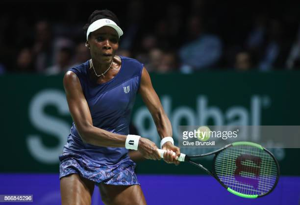 Venus Williams of the United States plays a backhand in her singles match against Garbine Muguruza of Spain during day 5 of the BNP Paribas WTA...