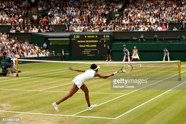 Venus Williams of The United States plays a forehand during the Ladies Singles final against Garbine Muguruza of Spain on day twelve of the Wimbledon...