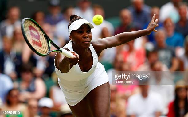 Venus Williams of the United States plays a forehand in her Ladies' Singles Fourth Round match against Serena Williams of the United States during...