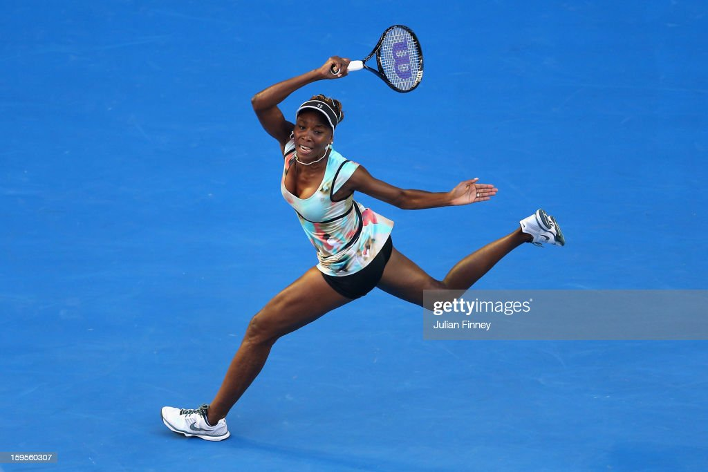 Venus Williams of the United States plays a forehand in her second round match against Alize Cornet of France during day three of the 2013 Australian Open at Melbourne Park on January 16, 2013 in Melbourne, Australia.
