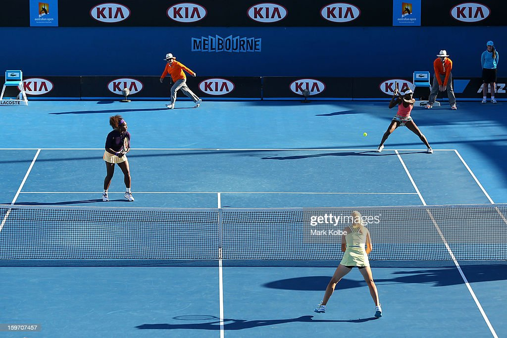 Venus Williams of the United States plays a forehand in her second round doubles match with Serena Williams of the United States against Vera Dushevina of Russia and Olga Govortsova of Belarus during day six of the 2013 Australian Open at Melbourne Park on January 19, 2013 in Melbourne, Australia.
