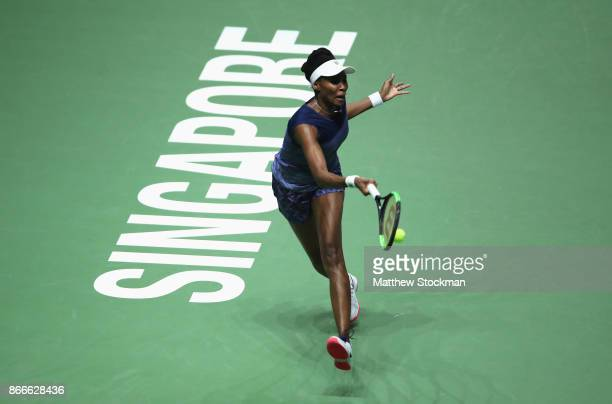 Venus Williams of the United States plays a forehand in her singles match against Garbine Muguruza of Spain during day 5 of the BNP Paribas WTA...