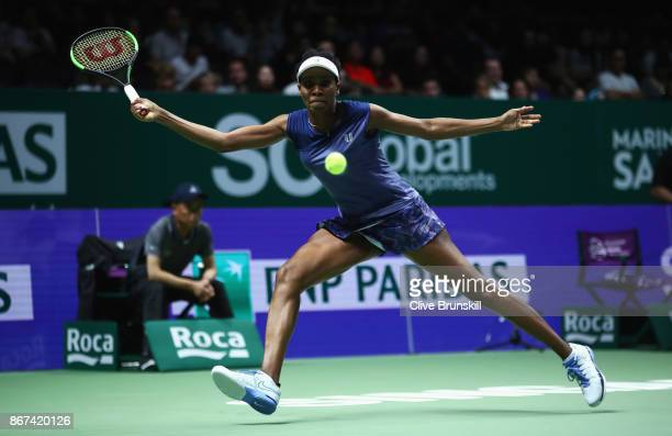 Venus Williams of the United States plays a forehand in her singles semi final match against Caroline Garcia of France during day 7 of the BNP...