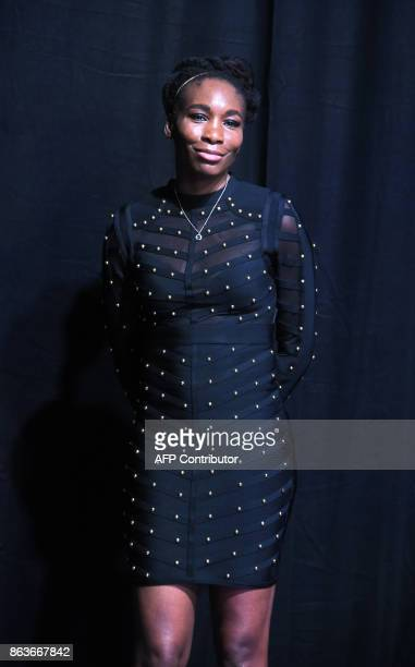 Venus Williams of the United States poses for photographers duirng the Official Draw Ceremony of the WTA Finals Singapore on October 20 2017 The WTA...
