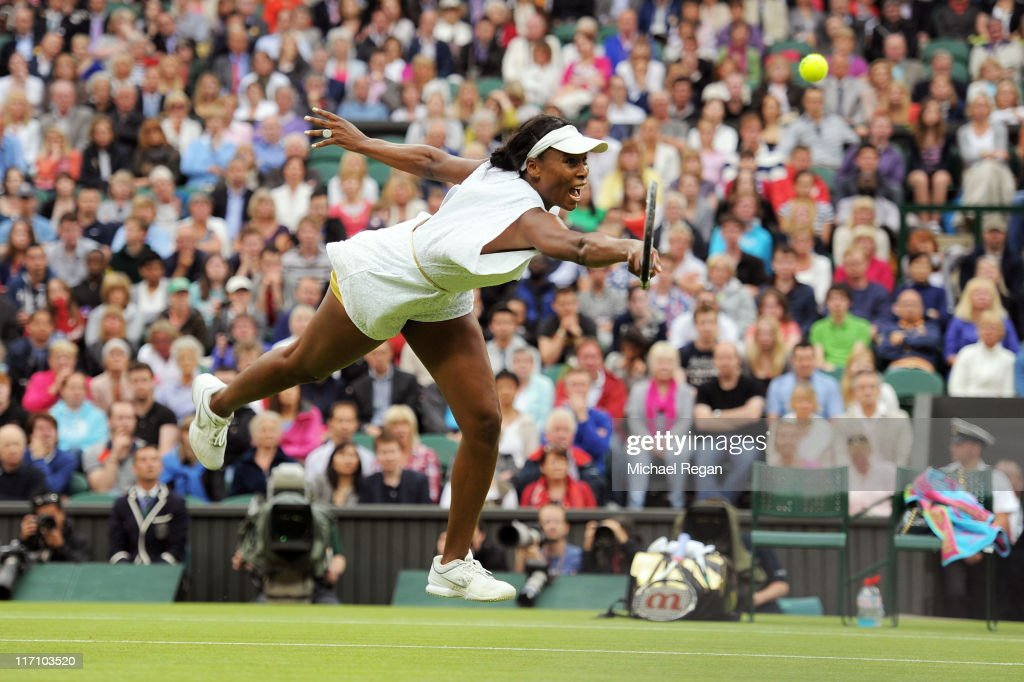 <a gi-track='captionPersonalityLinkClicked' href=/galleries/search?phrase=Venus+Williams&family=editorial&specificpeople=171981 ng-click='$event.stopPropagation()'>Venus Williams</a> of the United States reaches for a shot during her second round match against Kimiko Date-Krumm of Japan on Day Three of the Wimbledon Lawn Tennis Championships at the All England Lawn Tennis and Croquet Club on June 22, 2011 in London, England.