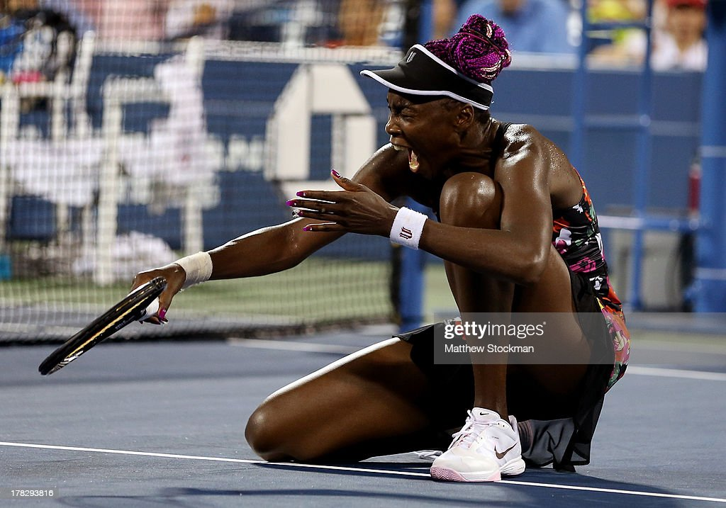 Venus Williams of the United States reacts after slipping on the court during her women's singles second round match against Jie Zheng of China on Day Three of the 2013 US Open at USTA Billie Jean King National Tennis Center on August 28, 2013 in the Flushing neighborhood of the Queens borough of New York City.