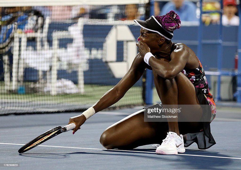 <a gi-track='captionPersonalityLinkClicked' href=/galleries/search?phrase=Venus+Williams&family=editorial&specificpeople=171981 ng-click='$event.stopPropagation()'>Venus Williams</a> of the United States reacts after slipping on the court during her women's singles second round match against Jie Zheng of China on Day Three of the 2013 US Open at USTA Billie Jean King National Tennis Center on August 28, 2013 in the Flushing neighborhood of the Queens borough of New York City.