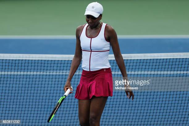 Venus Williams of the United States reacts against Ashleigh Barty of Australia during Day 5 of the Western and Southern Open at the Lindner Family...